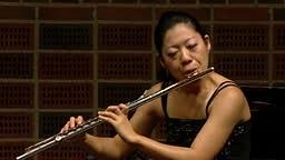Butterfly fails to faze flautist