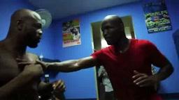 Bernard Hopkins teaches Rashad Evans how to throw a right hand