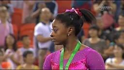 Gymnast Simone Biles runs from bee on podium