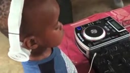 How CUTE Is this 4 Year old DJ?!!! And he's AFFORDABLE, You Can pay him in fruit snacks!!! lol