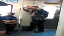 LOL! Watch this guy FALL ASLEEP STANDING UP On The Train!