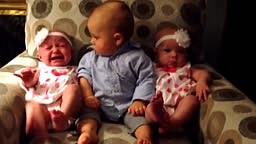 Adorable confused baby meets twins