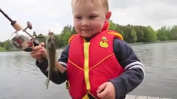 Kids cute reaction to catching his first fish with dad