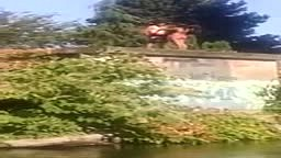 FAIL!! Man Tries Jumping Into Water But His Girlfriend Trips Him BAD!