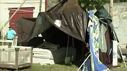 Outraged protesters gathered at a Philadelphia lot discover SIX homeless families living there