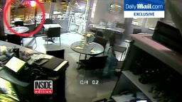 Watch Woman ESCAPE After Paris Attackers AK 47 Gun Jams in Cafe Surveillance