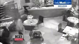 Watch Woman ESCAPE After Paris Attackers AK 47 Gun Jams in Cafe Surveillance