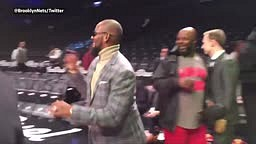 R KELLY HITS a THREE POINTER WHILE CHEWING ON A CIGAR AT NETS GAME
