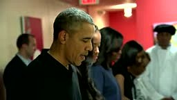 President Obama serves Thanksgiving Turkey dinners