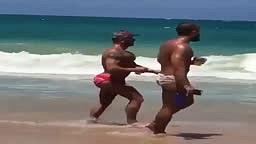 Watch Guy With Fake Butt Walk Down Beach On Spring Break
