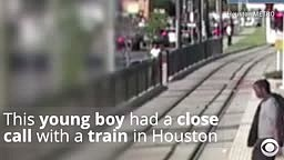 Footage Shows Boy Mere Inches Away From Getting Hit By A Train