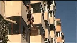 Dangling woman caught by boyfriend after falling out window