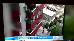 Child in China Falls Thru Railing Hangs four floors by His H